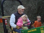 My niece gets a ride on Ike's tractor
